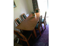 6 seat expanding wooden dining table