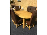 Solid oak extending table-£260,, quality heavy chairs-£45 each
