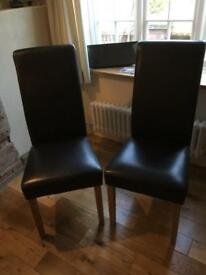 Two brown dining chairs