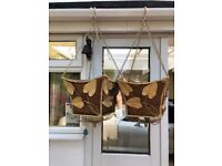 Antique looking cream hanging baskets