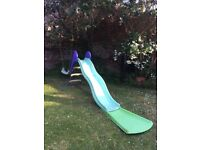 Garden slide with extension to have more fun. It has discoloured due to the sun.