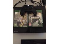 Xbox one good condition with one controller and Fifa 17 and cod infinite warfare and cod4 remastered