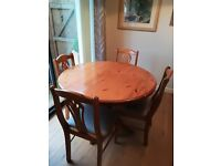 Pine pedestal extending dining table and 4 chairs