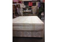 Double divan bed with ornate headboard