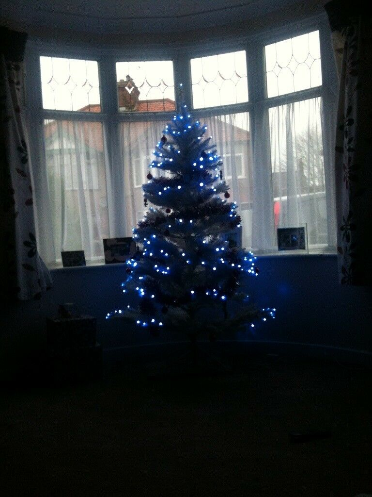 pre lit white christmas tree with blue lights