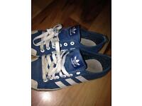 Blue and white adidas trainers
