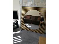 Extra large one of a kind black and gold square framed circular mirror