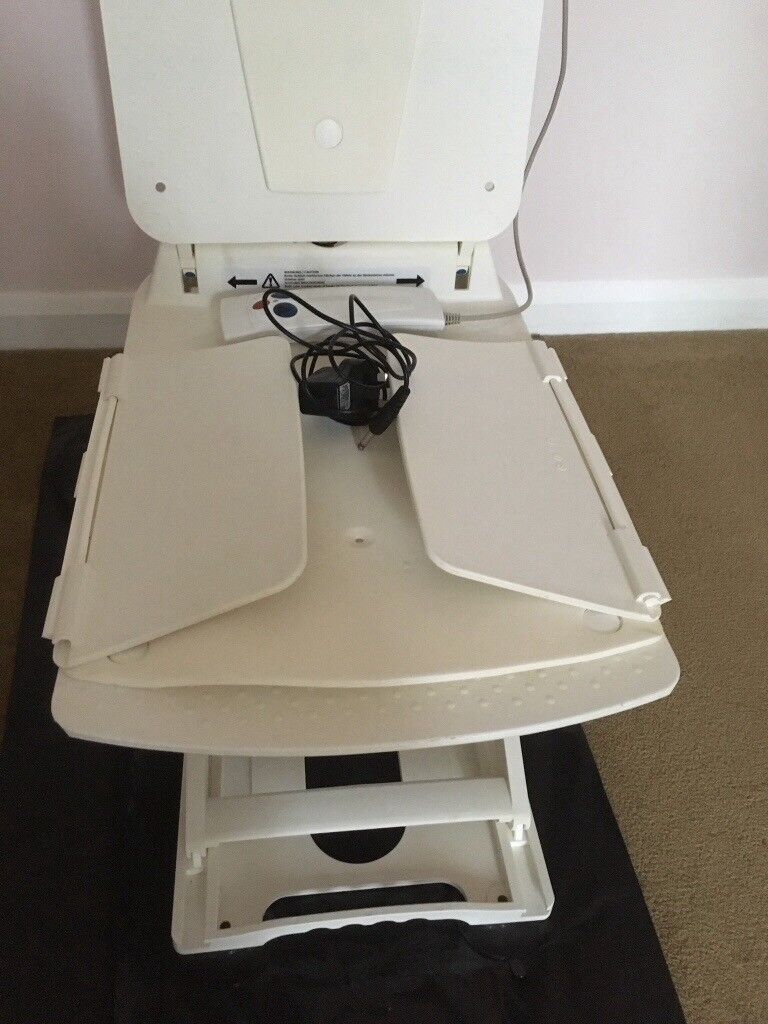 Electric bath chair. Operated by a rechargeable hand held control ...