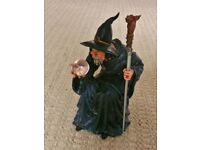 Wizard with Dragon Head Staff Sitting on Skulls Holding Crystal Ball Ornament Figurine Collectible