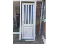 White uPVC door and frame with glass windows