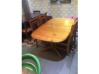 Pine wood dinning table with 4 chairs up for grabs