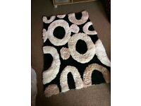 Shaggy black white rug in excellent condition 150 cm by 90 cm