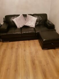Black leather 3 seater sofa with footstool storage