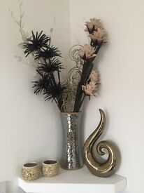 Gold vase with artificial flowers