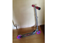 Girls pink Nebulus 2 wheeled scooter and ABUS smiley helmet