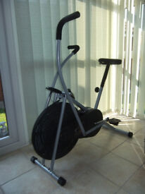 Exercise bike with air wheel and arm exercise.