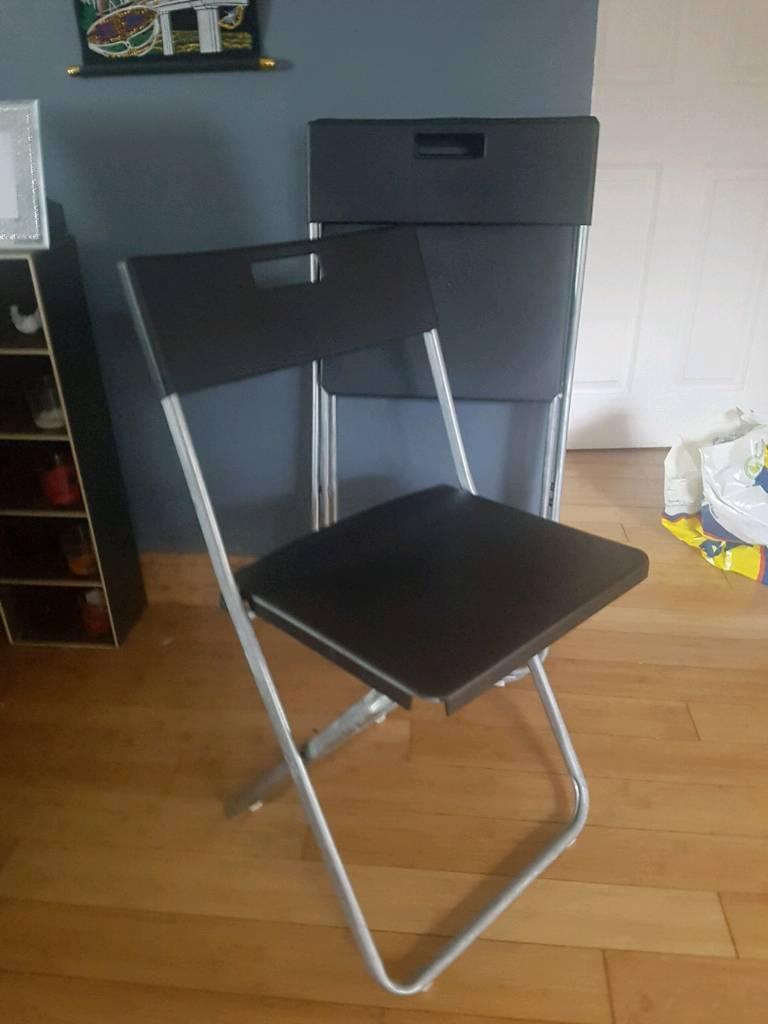 3 black chairs