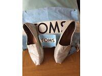 Toms, silver glitter size 6.