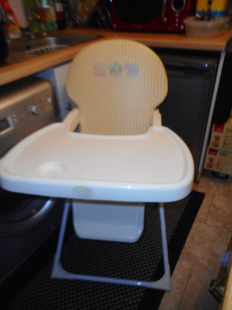 white and yellow folding high chair