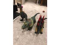 Three large plastic dinosaurs
