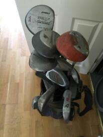Selection of golf clubs in bag