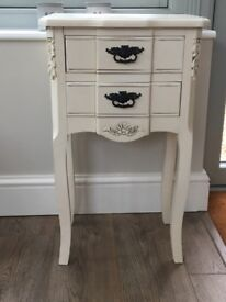 Beautiful, cream occasional side table with black detail drop handles. Carved detailing on front.