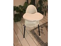 White and black baby Bjorn high chair