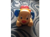 FisherPrice- Laugh & Learn stride to ride puppy