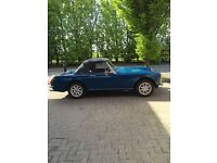 1974 Blue MG Midget for sale – highly desirable, immaculate condition – with chrome bumpers.