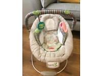 Baby bouncer, plays music and vibrates