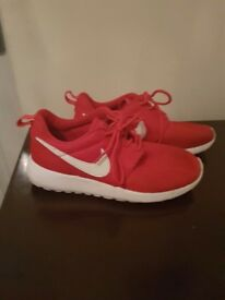Red nike roshe trainers size 3