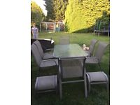 Metal and glass table, 6 chairs and 2 foot stalls