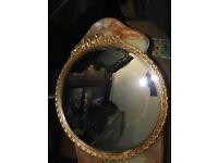 antique circular gilt framed wall mirror with ribbon (bow) decoration