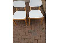A quartet of kitchen chairs