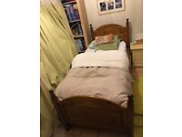 Single bed frame, with a guest bed frame underneath.