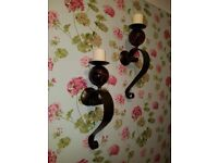 Two heavy wall sconces