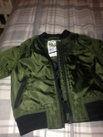Toddlers next bomber jacket, age 6-9 months£5