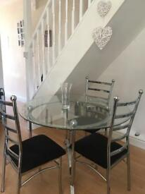 Glass Dining room table and 3 chairs