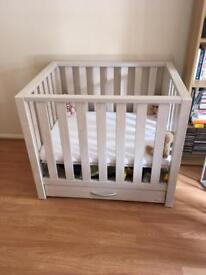 Wooden playpen with storage drawer