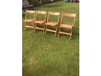 Four solid wood fold up chairs ( can deliver )