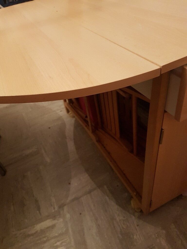 Fold up space saving dining room table with space for 4 chairs also 2 storage draws