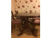 Antique cherrywood dining table and four chairs