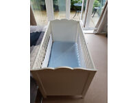 White cot including mattress and duvet
