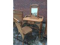 Great quality wicker style dressing table with matching mirror and chair. Delivery available