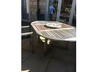 Solid teak dinning table and chairs