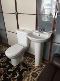 White Bathroom pedestal sink & close coupled toilet