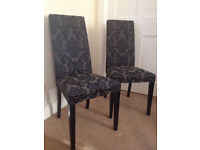 One black chair in wood with floral patterns