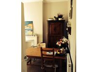 Pine wood IKEA dining table and 2 chairs
