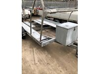 Car transporter trailer with tyre rack and jerry can holder