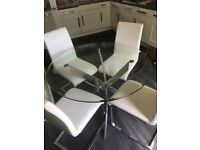 *Reduced Price* Glass top table with 4 leather style chairs